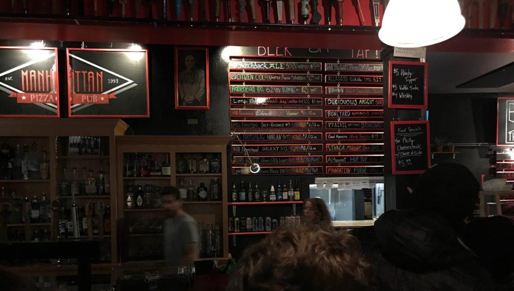 Beer list at Manhattan Pizza. Photo by Tyler Machado.
