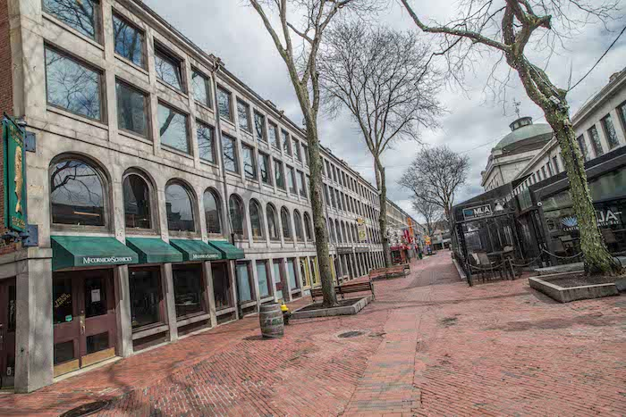 PHOTO OF AN EMPTY FANEUIL HALL BY DEREK KOUYOUMJIAN for The Dig